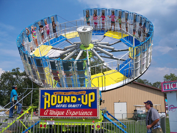 This is the POS Round Up. No dropping floor, and each victim is embraced by a tiny cage. Non-insane children found this ride offensively lame.